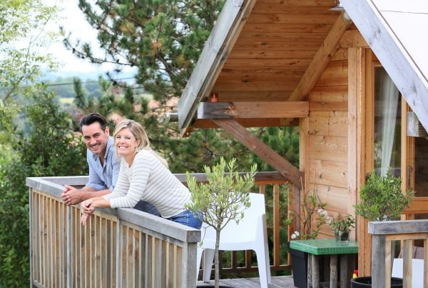 Couple on the Balcony of their Vacation Home